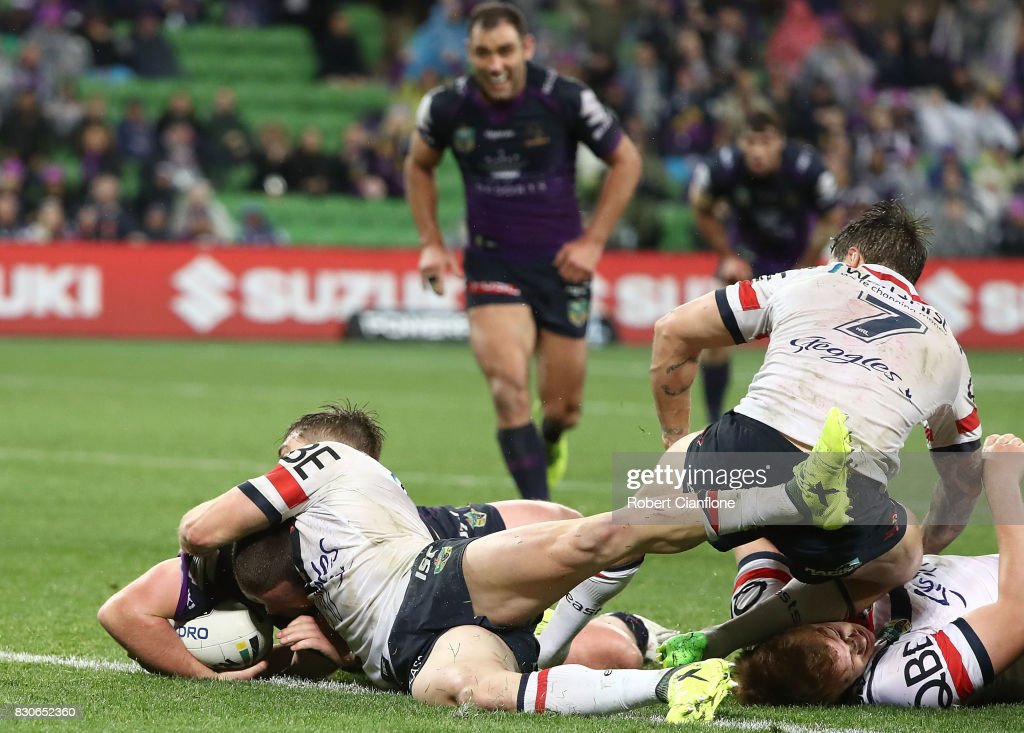 Joe Stimson of the Storm scores a try during the round 23 NRL match between the Melbourne Storm and the Sydney Roosters at AAMI Park on August 12, 2017 in Melbourne, Australia.