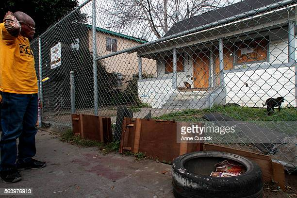 Joe Stringer with ACCE looks at the foreclosed home at 1457 East 48th Street owned by Bank of NY Mellon during a tour of foreclosed homes in Los...