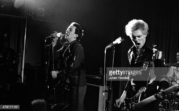 Joe Strummer and Paul Simonon performing with British punk group The Clash at the Coliseum, Harlesden, London, 11th March 1977.
