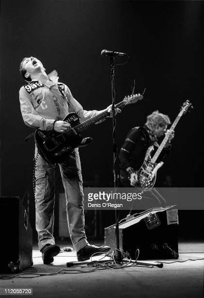 Joe Strummer and Paul Simonon performing with English punk group The Clash at the Rainbow Theatre London 1977