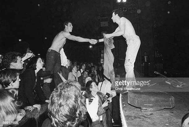 Joe Strummer , lead singer of punk rock band The Clash, exchanges shirts with a fan at The Rainbow Theatre, London at a concert on the group's 'White...