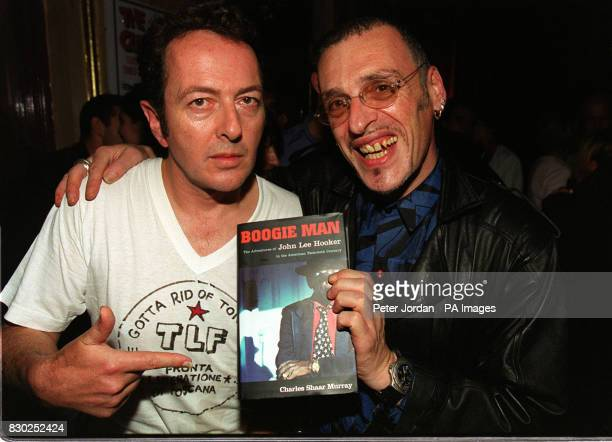 Joe Strummer member of The Clash and writer Charles Shaar Murray at the premiere of the BBC2 documentary Westway To The World in Notting Hill in...