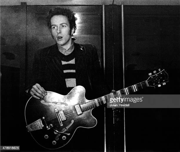 Joe Strummer of English pub rock group The 101ers in the doorway of The Colonnades Porchester Square London 1976 Strummer joined The Clash later in...