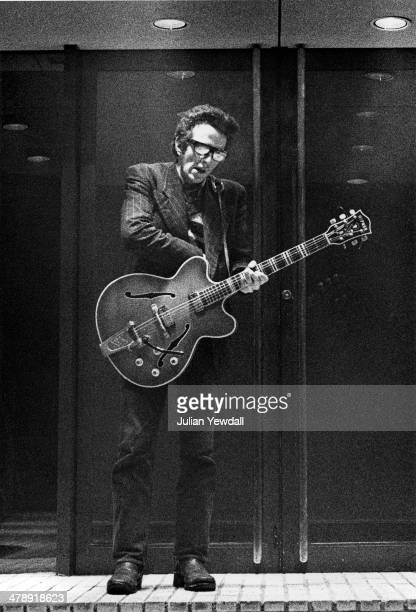 Joe Strummer of English pub rock group The 101ers, with his guitar in the doorway of The Colonnades Porchester Square, London, 1976. Strummer joined...