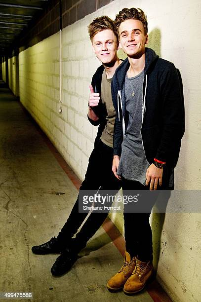 Joe Sugg and Caspar Lee pose backstage before meeting fans to celebrate the release of their new DVD 'Joe Caspar Hit The Road' at HMV on December 1...