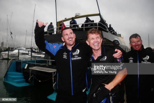 Joe Sullivan cyclist and Sean Regan boat building team of Emirates Team New Zealand wave to the supporters as they come of the explorer yacht after...