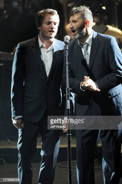 Joe Sumner and Jimmy Nail perform on stage during STING 25th Anniversary/60th Birthday Concert to Benefit Robin Hood Foundation at Beacon Theatre on...