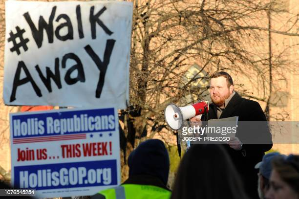 Joe Sweeney communications director for the New Hamshire GOP speaks to rally goers before calling the rally and sending people inside during the...