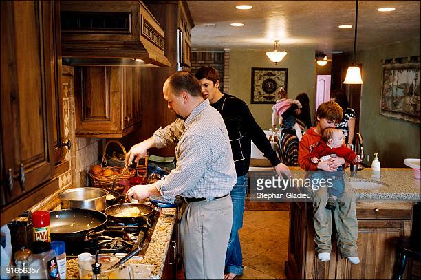 Joe the patriarch of a polygamist family consisting of one man three women and 21 children makes a gigantic omelet for Sunday brunch while talking to...