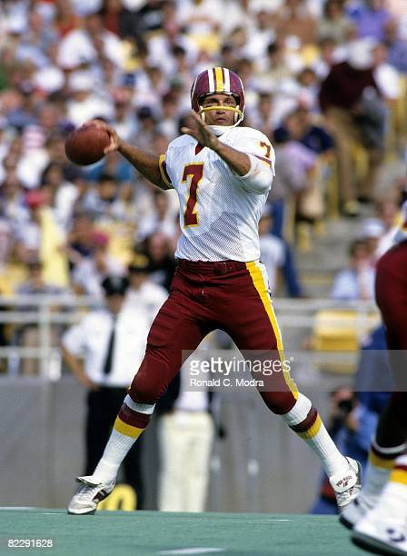 Joe Theismann of the Washington Redskins goes back to pass during a NFL game against the Chicago Bears on September 28 1985 in Chicago Illinois