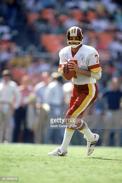 Joe Theismann of the Washington Redskins moves as he looks to pass during a 1984 NFL season game