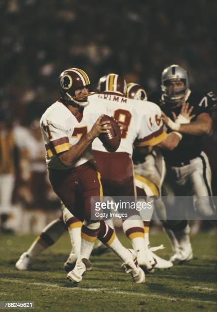 Joe Theismann, Quarterback for the Washington Redskins takes the snap prepares to the throw the ball during the National Football League Super Bowl...