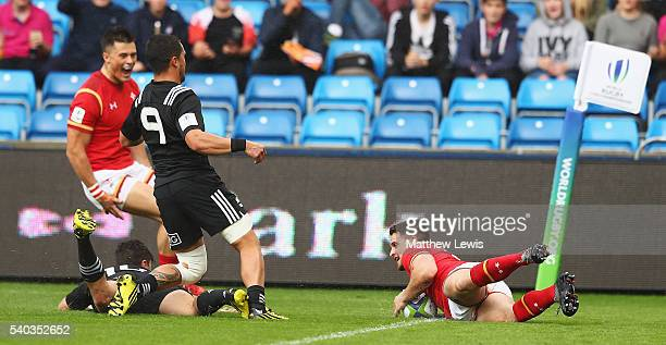 Joe Thomas of Wales celebrates scoring a try during the World Rugby U20 Championship match between New Zealand and Wales at AJ Bell Stadium on June...