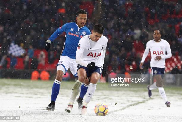 Joe Thompson of Rochdale battles with Erik Lamela of Tottenham Hotspur during The Emirates FA Cup Fifth Round Replay between Tottenham Hotspur and...