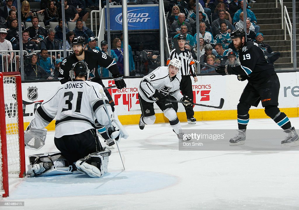 Joe Thornton #19 and Brent Burns #88 of the San Jose Sharks attack the net against Tanner Pearson #70 and Martin Jones #31 of the Los Angeles Kings during an NHL game on April 3, 2014 at SAP Center in San Jose, California.