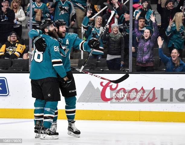 Joe Thornton and Brent Burns of the San Jose Sharks celebrate a goal against the Pittsburgh Penguins at SAP Center on January 15 2018 in San Jose...