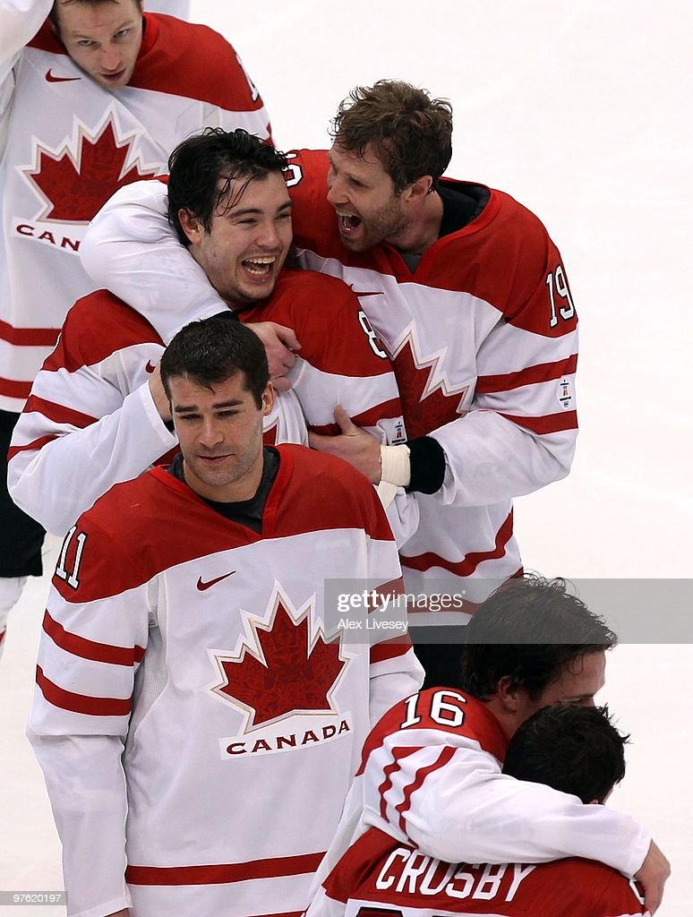 Joe Thornton #19 and Drew Doughty #8 of Canada celebrate after the ice hockey men's gold medal game between USA and Canada on day 17 of the Vancouver 2010 Winter Olympics at Canada Hockey Place on February 28, 2010 in Vancouver, Canada. Canada defeated USA 3-2 in overtime.