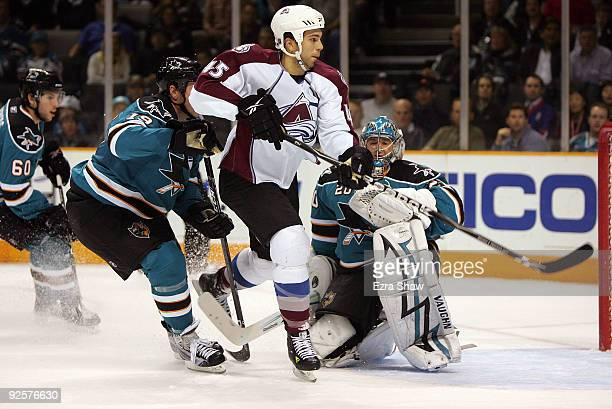 Joe Thornton and goalie Evgeni Nabokov of the San Jose Sharks defend against Chris Durno of the Colorado Avalanche during the first period of their...