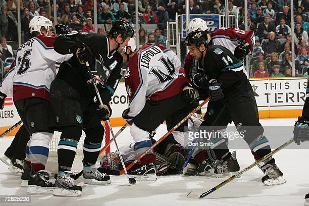 Joe Thornton and Jonathan Cheechoo of the San Jose Sharks battle in front of the net during a game against the Colorado Avalanche on December 7, 2006...
