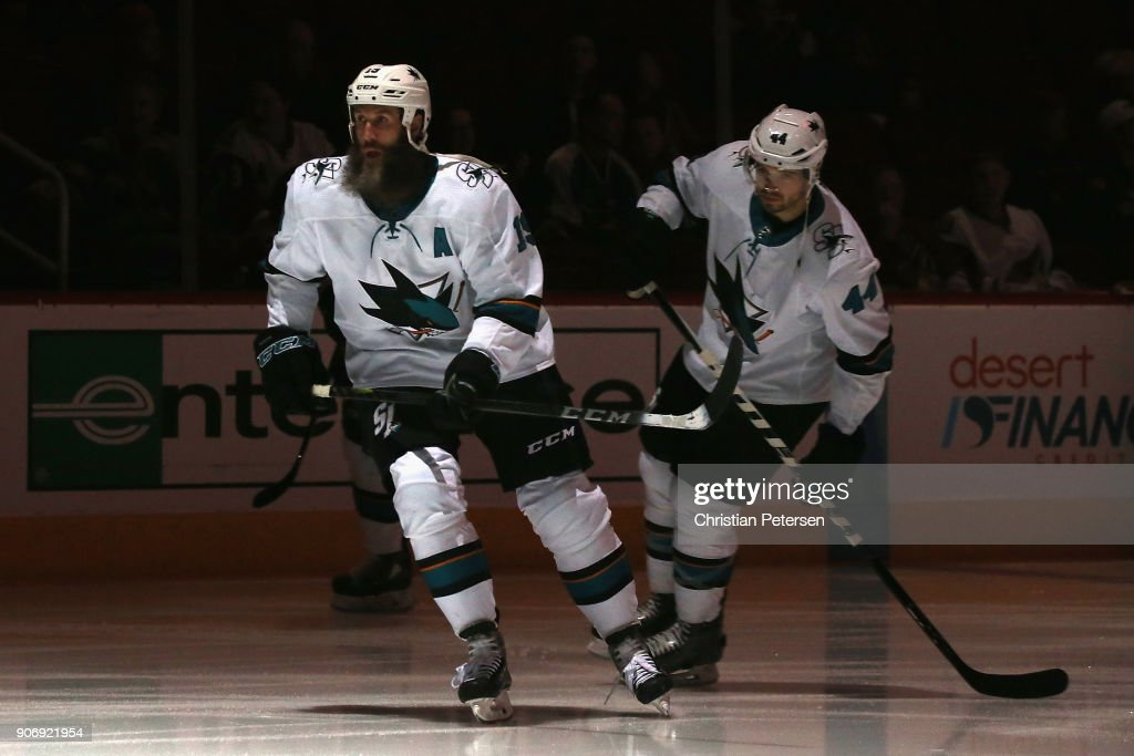 Joe Thornton #19 and Marc-Edouard Vlasic #44 of the San Jose Sharks skate on the ice before the NHL game against the Arizona Coyotes at Gila River Arena on January 16, 2018 in Glendale, Arizona. The Sharks defeated the Coyotes 3-2 in an overtime shootout.