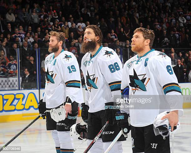 Joe Thornton Brent Burns and Joe Pavelski of the San Jose Sharks stand for the singing of the national anthem prior to a game against the Edmonton...