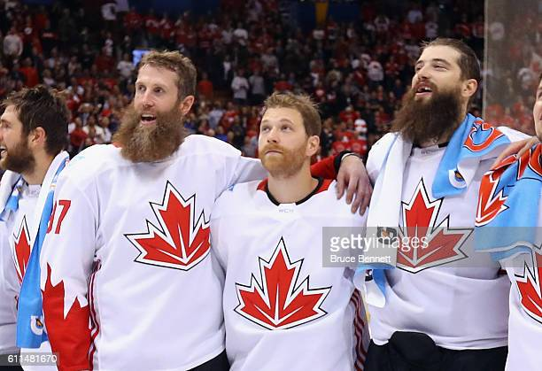 Joe Thornton Claude Giroux and Brent Burns of Team Canada sing the national anthem following a 21 victory over Team Europe in Game Two of the World...
