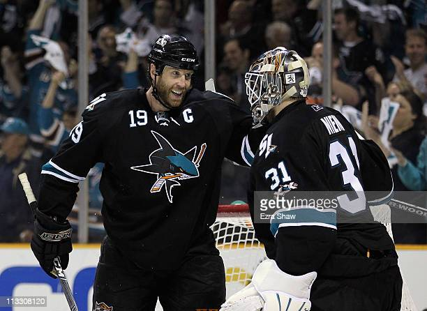 Joe Thornton congratulates Antti Niemi of the San Jose Sharks after they beat the Detroit Red Wings in Game Two of the Western Conference Semifinals...