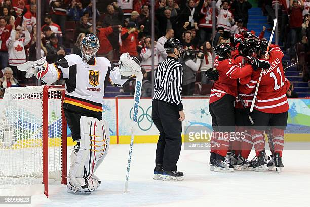 Joe Thornton of Canada celebrates with his teammates after scoring a goal past Thomas Greiss of Germany during the ice hockey Men's Qualification...