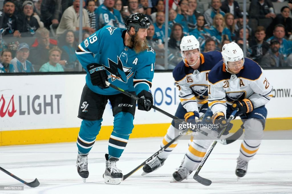 Joe Thornton #19 of the San Jose Sharks along with Jack Eichel #15 and Kyle Okposo #21of the Buffalo Sabres chase the puck at SAP Center at San Jose on October 12, 2017 in San Jose, California.