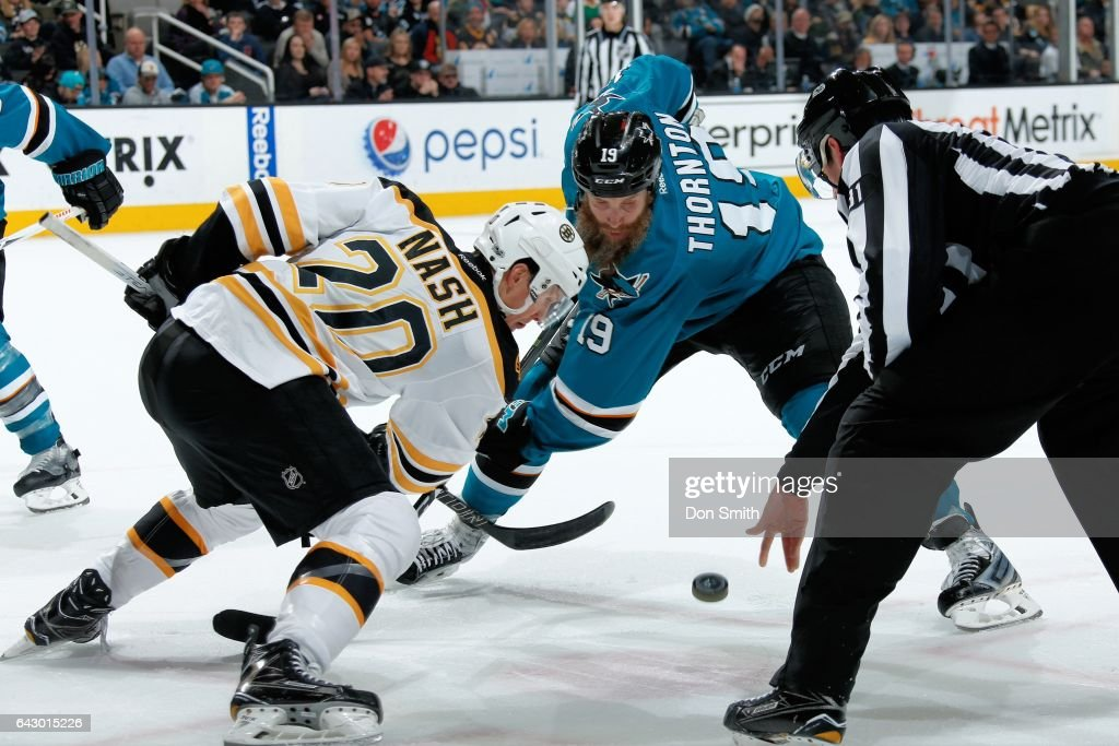 Joe Thornton #19 of the San Jose Sharks and Riley Nash #20 of the Boston Bruins face off at SAP Center at San Jose on February 19, 2017 in San Jose, California.
