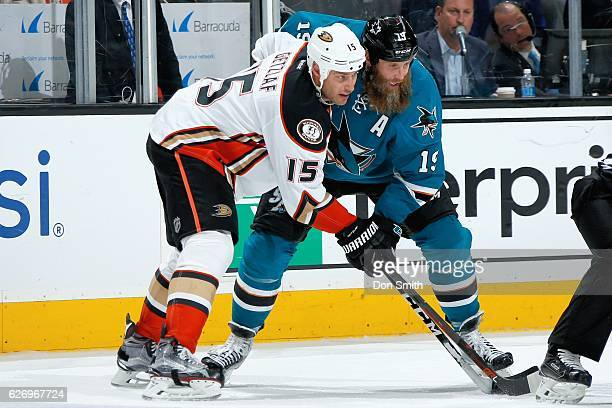 Joe Thornton of the San Jose Sharks and Ryan Getzlaf of the Anaheim Ducks get ready during a face off during a NHL game at SAP Center at San Jose on...