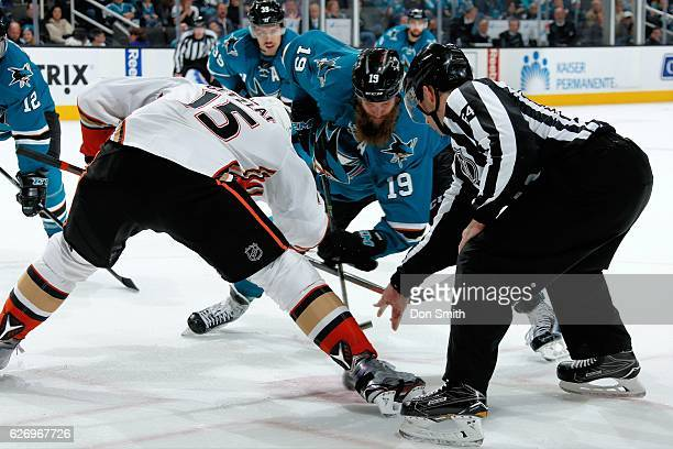 Joe Thornton of the San Jose Sharks and Ryan Getzlaf of the Anaheim Ducks face off during a NHL game at SAP Center at San Jose on November 26, 2016...