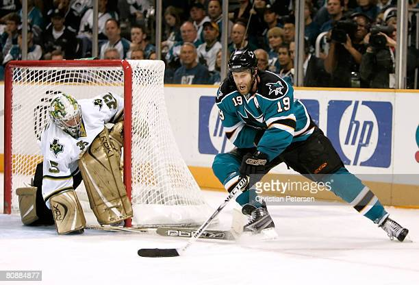 Joe Thornton of the San Jose Sharks attempts a wrap around shot on goaltender Marty Turco of the Dallas Stars during Game 2 of the Western Conference...