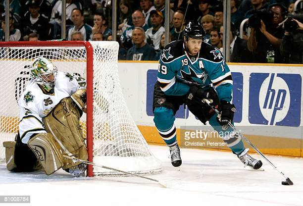 Joe Thornton of the San Jose Sharks attempts a wrap around shot on goaltender Marty Turco of the Dallas Stars during game two of the Western...