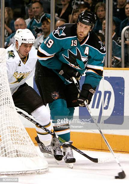 Joe Thornton of the San Jose Sharks attempts to center the puck under pressure from Nicklas Grossman of the Dallas Stars during Game 2 of the Western...