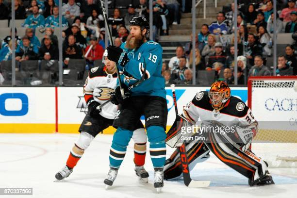 Joe Thornton of the San Jose Sharks attempts to screen Ryan Miller of the Anaheim Ducks at SAP Center on November 4 2017 in San Jose California