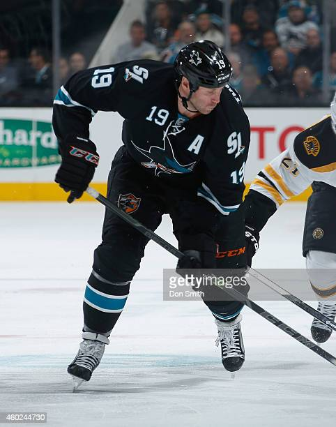 Joe Thornton of the San Jose Sharks battles for the puck against the Boston Bruins during an NHL game on December 4, 2014 at SAP Center in San Jose,...