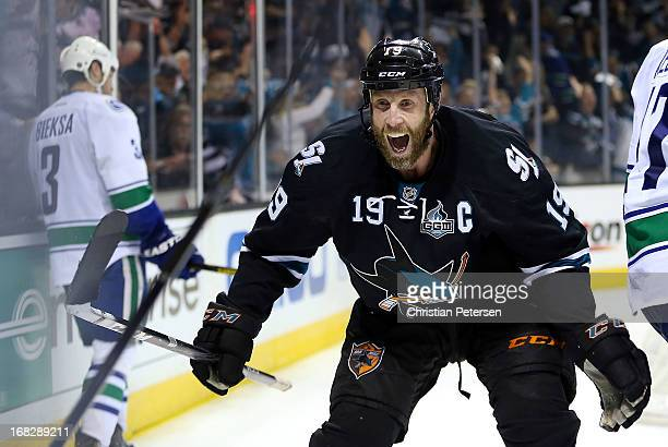 Joe Thornton of the San Jose Sharks celebrates after Patrick Marleau scored the game winning goal against Kevin Bieksa and the Vancouver Canucks in...