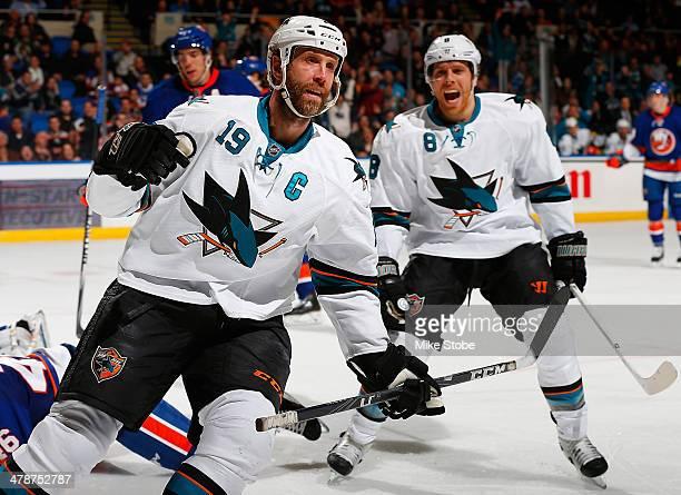 Joe Thornton of the San Jose Sharks celebrates his 2nd period goal with teammate Joe Pavelski against the New York Islanders at Nassau Veterans...