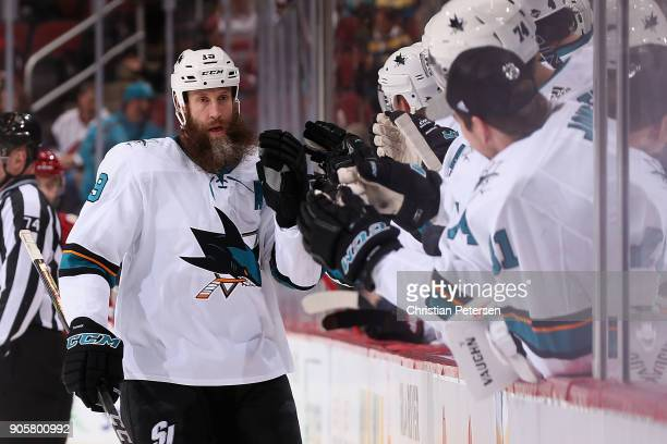 Joe Thornton of the San Jose Sharks celebrates with teammates on the bench after scoring a power play goal against the Arizona Coyotes during the...