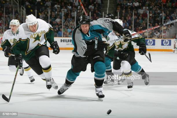 Joe Thornton of the San Jose Sharks chases the puck during a game against the Dallas Stars on April 9, 2006 at the HP Pavilion in San Jose,...
