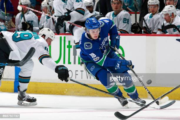 Joe Thornton of the San Jose Sharks checks Jake Virtanen of the Vancouver Canucks during their NHL game at Rogers Arena December 15 2017 in Vancouver...