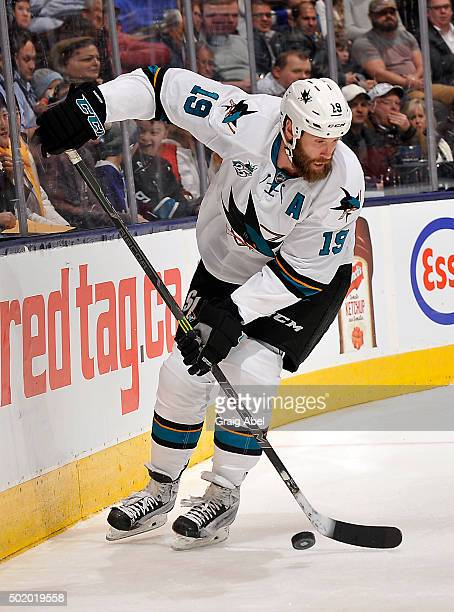 Joe Thornton of the San Jose Sharks controls the puck against the Toronto Maple Leafs during game action on December 17, 2015 at Air Canada Centre in...