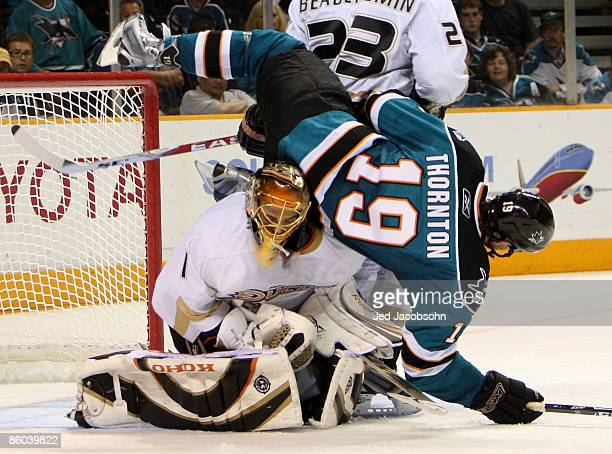 Joe Thornton of the San Jose Sharks crashes into goalie Jonas Hiller of the Anaheim Ducks during Game Two of the Western Conference Quarterfinals of...