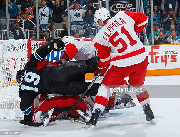 Joe Thornton of the San Jose Sharks crashes the net against Valterri Filppula and Niklas Kronwall of the Detroit Red Wings in Game Seven of the...