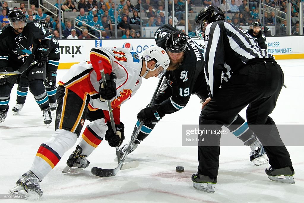 Joe Thornton #19 of the San Jose Sharks faces off against Mikael Backlund #11 of the Calgary Flames during a NHL game at SAP Center at San Jose on November 3, 2016 in San Jose, California.