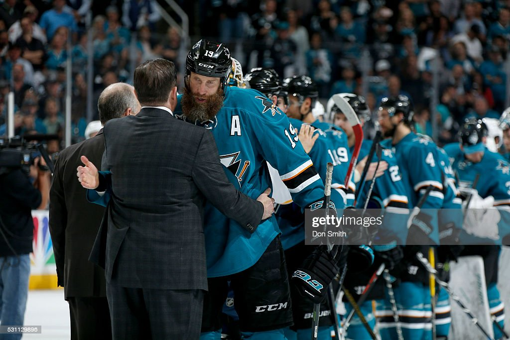 Joe Thornton #19 of the San Jose Sharks gets congratulated by head coach Peter Laviolette of the Nashville Predators in game seven of the Western Conference Second Round during the 2016 NHL Stanley Cup Playoffs at the SAP Center at San Jose on May 12, 2016 in San Jose, California.