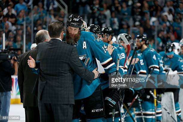 Joe Thornton of the San Jose Sharks gets congratulated by head coach Peter Laviolette of the Nashville Predators in game seven of the Western...