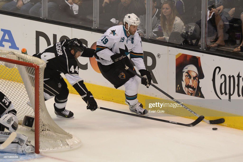 Joe Thornton #19 of the San Jose Sharks handles the puck against Robyn Regehr #44 of the Los Angeles Kings in Game Four of the First Round of the 2014 Stanley Cup Playoffs at STAPLES Center on April 24, 2014 in Los Angeles, California.