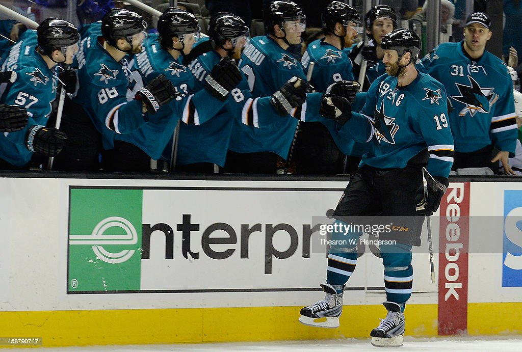 Joe Thornton #19 of the San Jose Sharks is congratulated by teammages after he scored the winning goal in an overtime shoot-out against the Dallas Stars at SAP Center on December 21, 2013 in San Jose, California. The Sharks won the game 3-2.